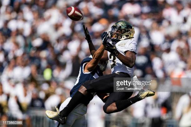 David Bell of the Purdue Boilermakers attempts to make a leaping catch against John Reid of the Penn State Nittany Lions during the first half at...