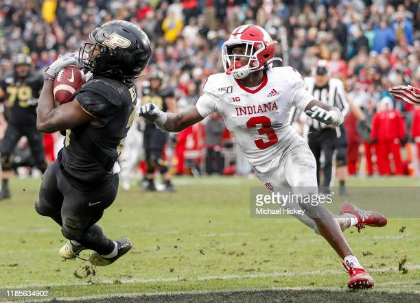 David Bell of the Purdue Boilermakers catches a pass for a touchdown late in the fourth quarter as Tiawan Mullen of the Indiana Hoosiers defends at...