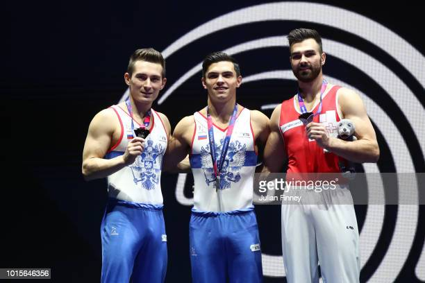 David Belyavskiy of Russia Artur Dalaloyan of Russia and Oliver Hegi of Switzerland pose for a photo at the podium after receiving their medals for...