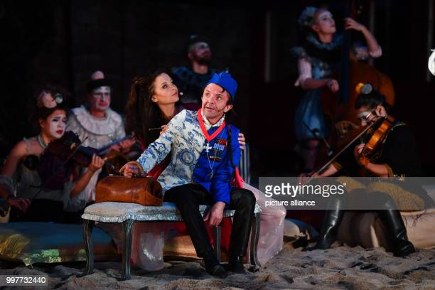 David Bennent as weapons trader Monsieur Vulture and Valerie Koch as double agent Lady Adler pictured on stage during the photo rehearsal for this...