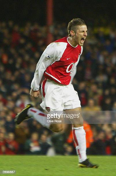 David Bentley of Arsenal celebrates scoring their fourth goal during the FA Cup Fourth round match between Arsenal and Middlesbrough at Highbury on...