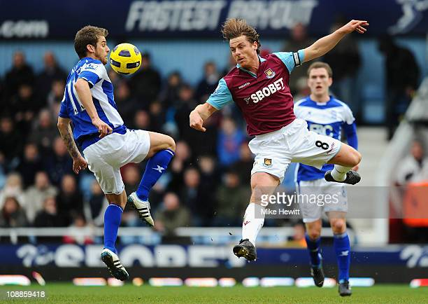 David Bentley of Birmingham City and Scott Parker of West Ham United battle for control of the ball during the Barclays Premier League match between...