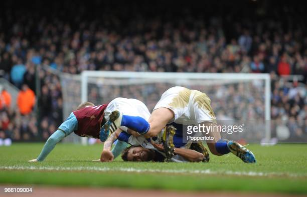 David Bentley of Birmingham City falls awkwardly during the Barclays Premier League match between West Ham United and Birmingham City at Upton Park...