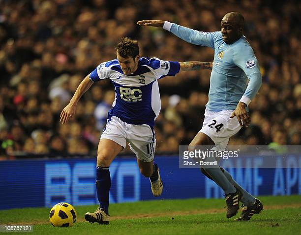 David Bentley of Birmingham City holds off a challenge from Patrick Vieira of Manchester City during the Barclays Premier League match between...