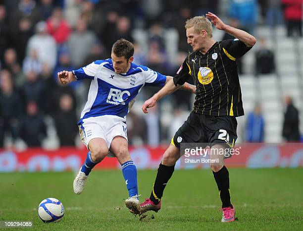 David Bentley of Birmingham City is challenged by Gary Teale of Sheffield Wednesday during the FA Cup Sponsored by eon 5th Round match between...