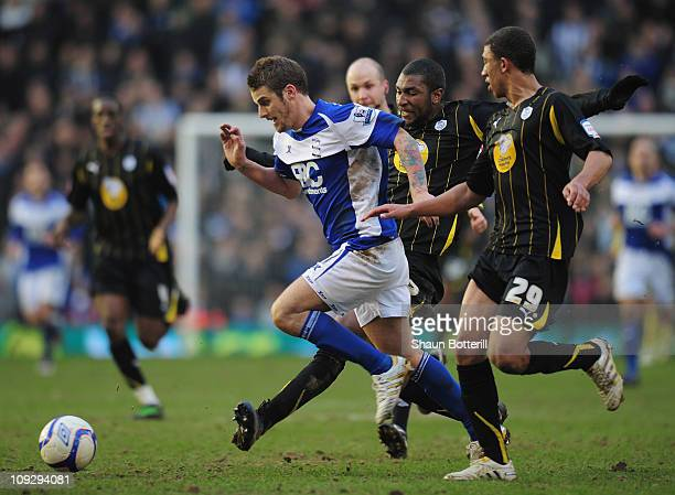 David Bentley of Birmingham City is challenged by Reda Johnson and Liam Palmer of Sheffield Wednesday during the FA Cup Sponsored by eon 5th Round...