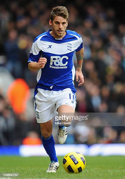 David Bentley of Birmingham City runs with the ball during the Barclays Premier League match between West Ham United and Birmingham City at the...