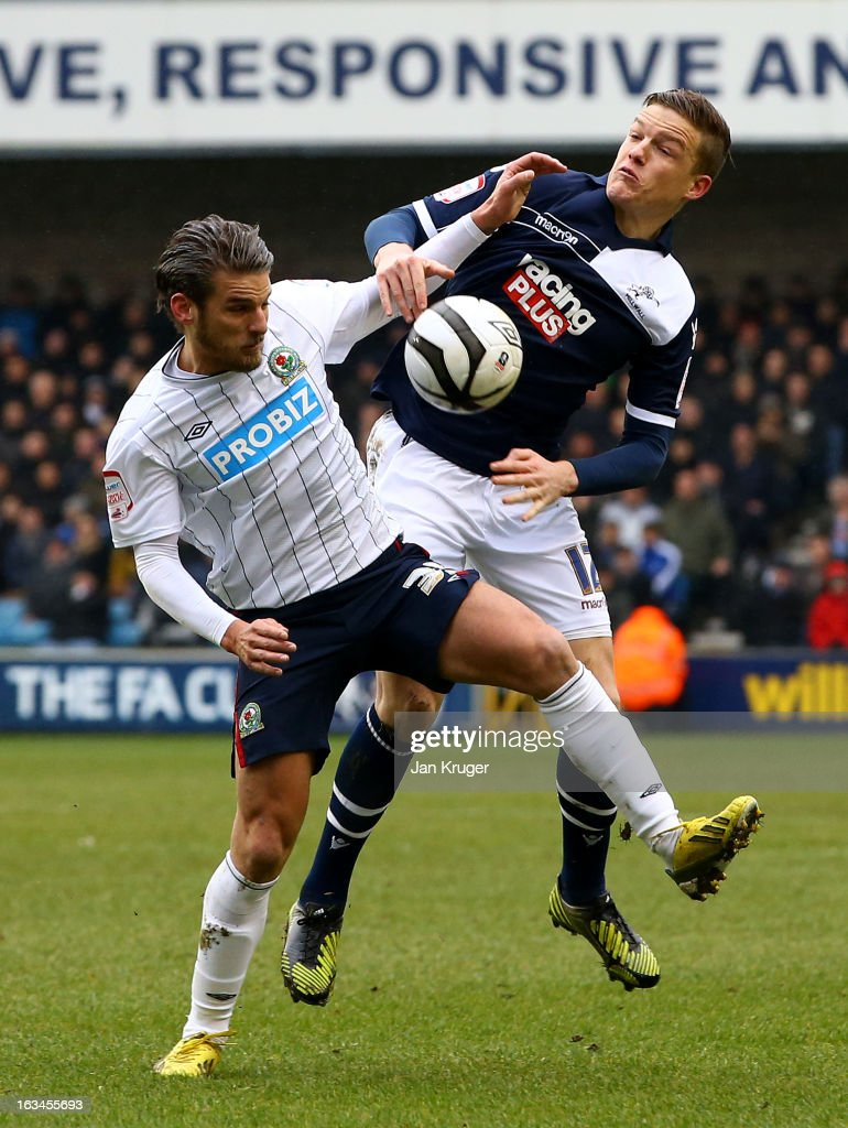 David Bentley of Blackburn Rovers battles with Shane Lowry of Millwall during the FA Cup sponsored by Budweiser sixth round match between Millwall and Blackburn Rovers at The Den on March 10, 2013 in London, England.