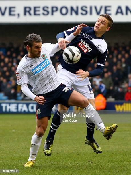 David Bentley of Blackburn Rovers battles with Shane Lowry of Millwall during the FA Cup sponsored by Budweiser sixth round match between Millwall...