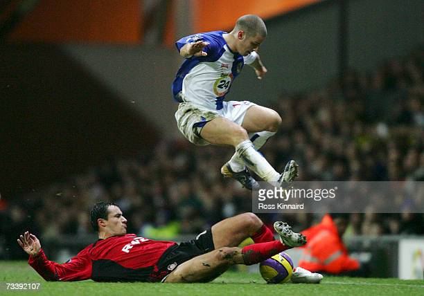 David Bentley of Blackburn Rovers hurdles the challenge of Marko Babic of Bayer Leverkusen during the UEFA Cup Round of 32 second leg match between...