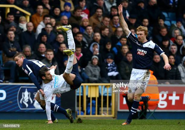 David Bentley of Blackburn Rovers loses his footing under pressure from Shane Lowry of Millwall during the FA Cup sponsored by Budweiser sixth round...