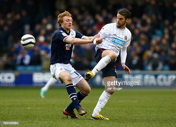 David Bentley of Blackburn Rovers steers the ball past Chris Taylor of Millwall during the FA Cup sponsored by Budweiser sixth round match between...