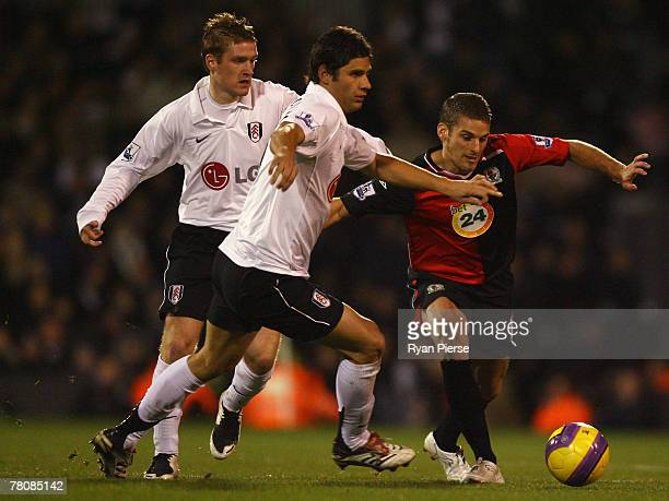 David Bentley of Blackburn Rovers takes on Steven Davis and Dejan Stefanovic of Fulham during the Barclays Premier League match between Fulham and...