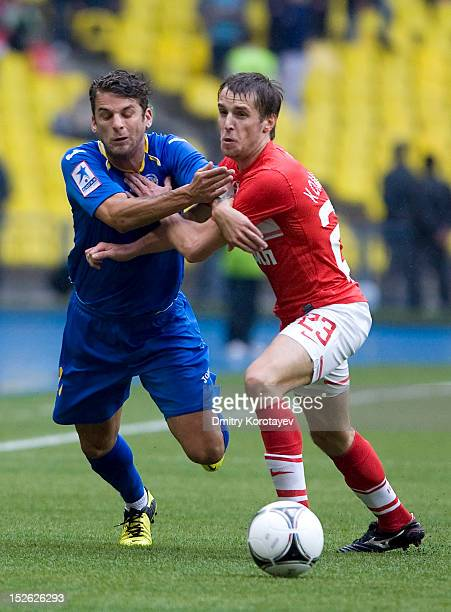 David Bentley of FC Rostov battles for the ball with Dmitri Kombarov of FC Spartak Moscow during the Russian Premier League match between FC Spartak...