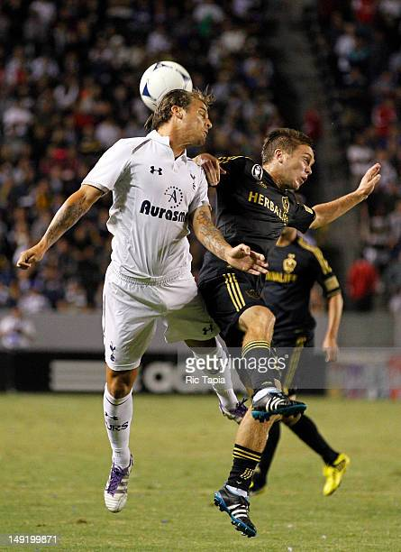 David Bentley of the Tottenham Hotspur heads the ball against Michael Stephens of Los Angeles Galaxy during the second half of the international...