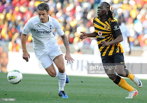David Bentley of Tottenham Hotspur and Reneilwe Letsholonyane of Kaizer Chiefs in action during the 2011 Vodacom Challenge match between Kaizer...