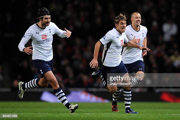 David Bentley of Tottenham Hotspur celebrates scoring with his team mates during the Barclays Premier League match between Arsenal and Tottenham...