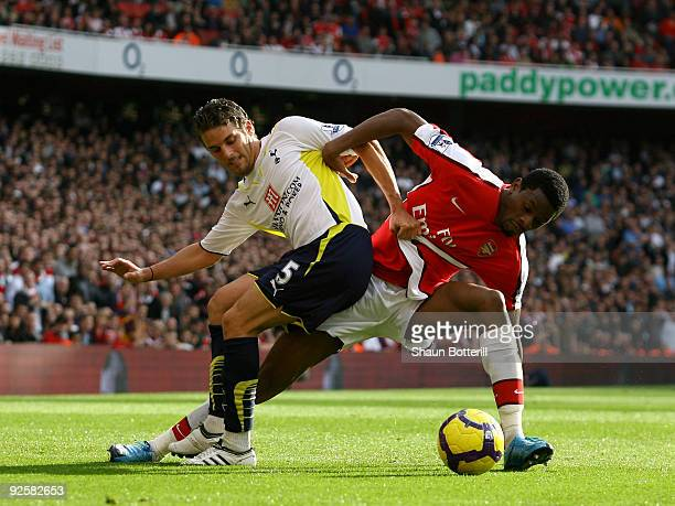 David Bentley of Tottenham Hotspur is challenged by Abou Diaby of Arsenal during the Barclays Premier League match between Arsenal and Tottenham...