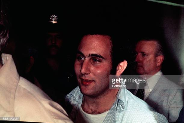 David Berkowitz a 24yearold postal worker is taken from the Gold Street station house to Brooklyn Criminal Courts Building Berkowitz was arrested...