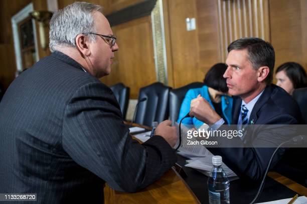 David Bernhardt President Donald Trump's nominee to be Interior Secretary speaks to Sen Martin Heinrich before the start of a Senate Energy and...