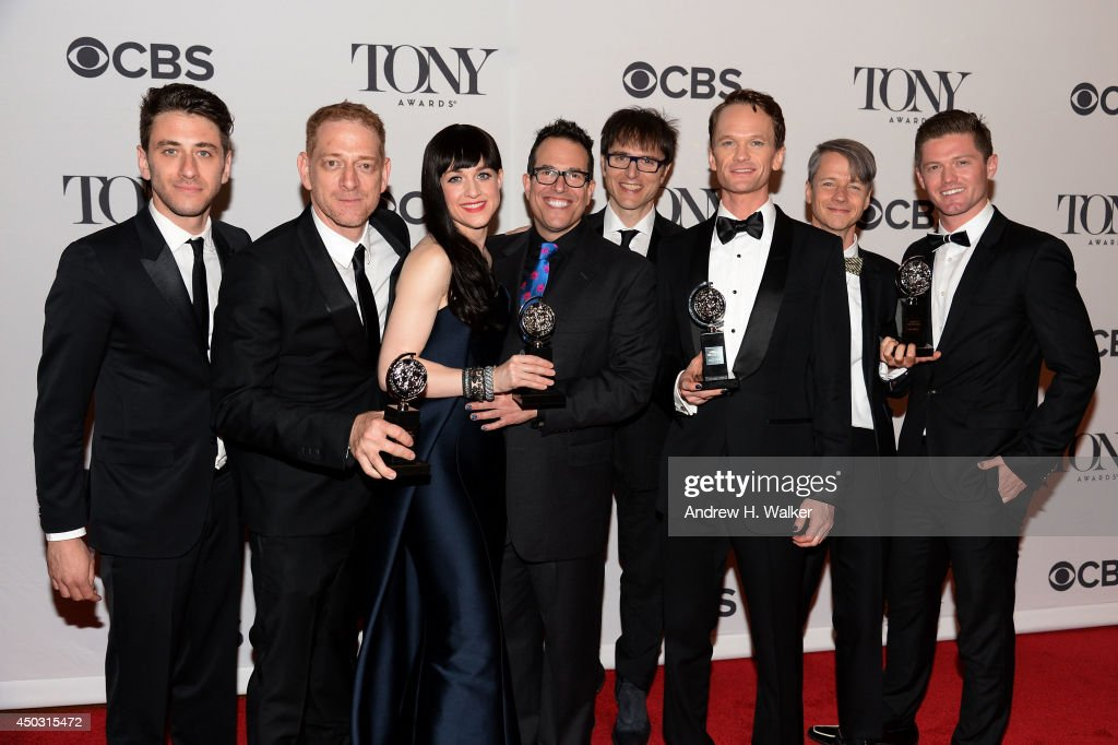 David Binder, Lena Hall, Neil Patrick Harris and the cast and crew of 'Hedwig and the Angry Inch' pose in the press room during the 68th Annual Tony Awards on June 8, 2014 in New York City.