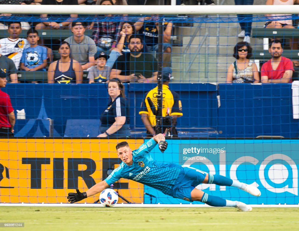 David Bingham #1 of Los Angeles Galaxy makes a save during the Los Angeles Galaxy's MLS match against Columbus Crew at the StubHub Center on July 7, 2018 in Carson, California. Los Angeles Galaxy won the match 4-0
