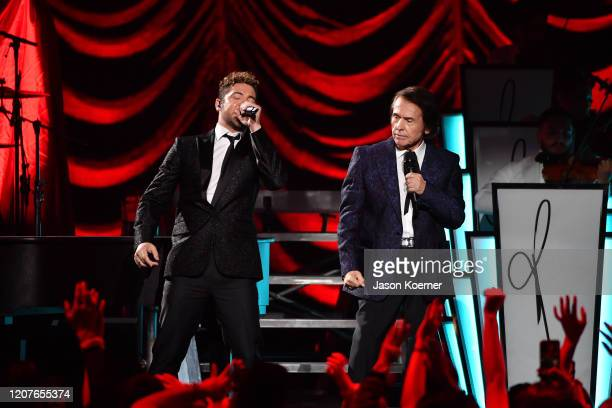 David Bisbal and Raphael perform live on stage during Univision's Premio Lo Nuestro 2020 at AmericanAirlines Arena on February 20 2020 in Miami...