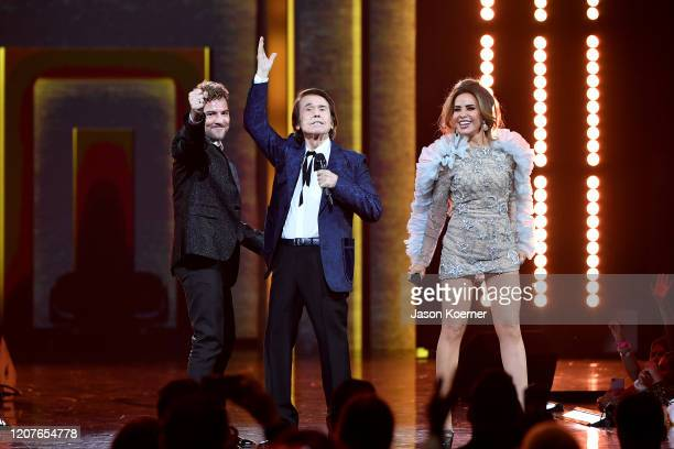 David Bisbal Raphael and Gloria Trevi on stage during Univision's Premio Lo Nuestro 2020 at AmericanAirlines Arena on February 20 2020 in Miami...