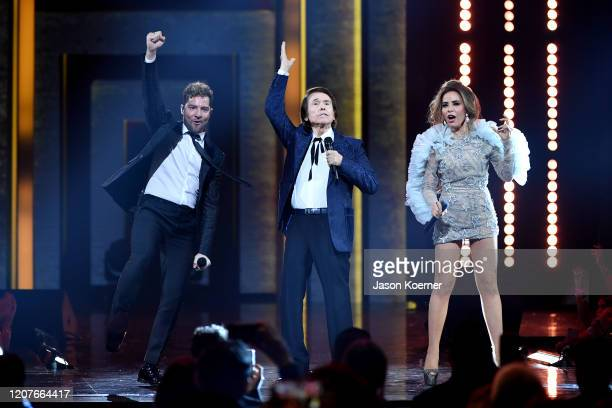 David Bisbal Raphael and Gloria Trevi perform live on stage during Univision's Premio Lo Nuestro 2020 at AmericanAirlines Arena on February 20 2020...