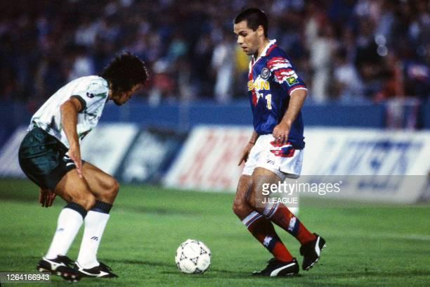 David Bisconti of Yokohama Marinos takes on Luiz Carlos Pereira of Verdy Kawsaki during the JLeague Suntory Series match between Yokohama Marinos and...