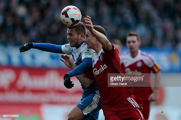 David Blacha of Rostock and Patrick Kohlmann of Kiel compete during the Third League match between Hansa Rostock and Holstein Kiel at DKBArena on...