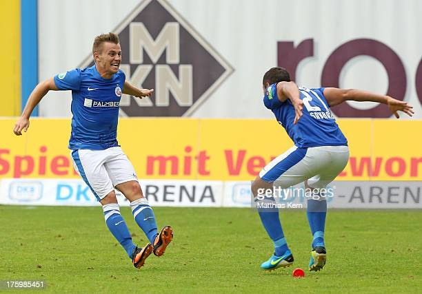 David Blacha of Rostock celebrates with team mate Halil Savran after scoring the fourth goal during the third league match between FC Hansa Rostock...
