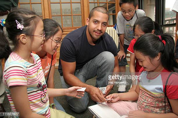 David Blaine and kids during Magician David Blaine Hands Out Books and Performs For Children August 25 2006 at Chatham Square Library in New York...