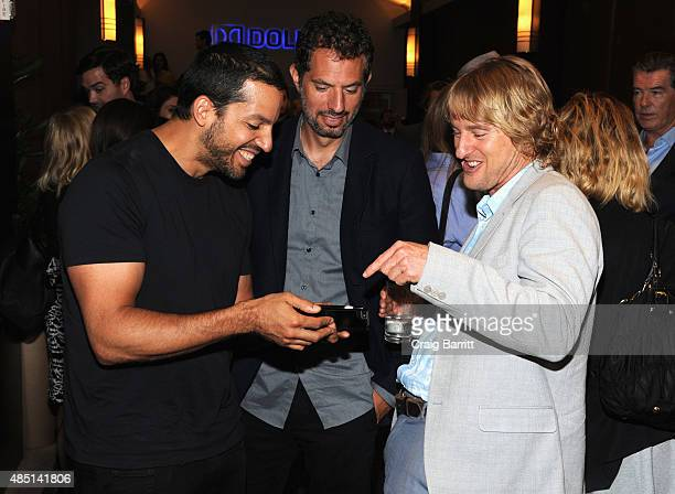 David Blaine Guy Oseary and Owen Wilson attend the special screening of NO ESCAPE with Owen Wilson Lake Bell and Pierce Brosnan at Dolby 88 Theater...