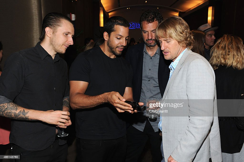 David Blaine, Guy Oseary and Owen Wilson attend the special screening of NO ESCAPE with Owen Wilson, Lake Bell and Pierce Brosnan at Dolby 88 Theater on August 24, 2015 in New York City.
