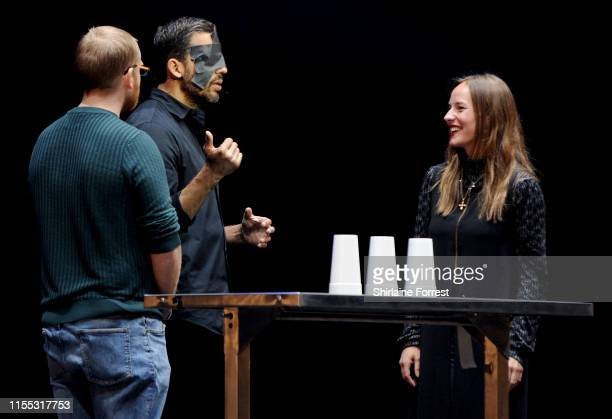 David Blaine performs the cups and ball trick using a ice pick as the ball on stage at O2 Apollo Manchester on June 11 2019 in Manchester England