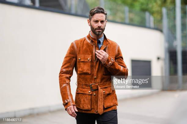 David Blakeley wears a fawncolor suede jacket during London Fashion Week Men's June 2019 on June 09 2019 in London England