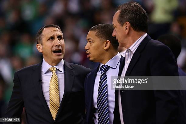 David Blatt of the Cleveland Cavaliers talks with Tyronn Lue during the fourth quarter against the Boston Celtics in the first round of the 2015 NBA...