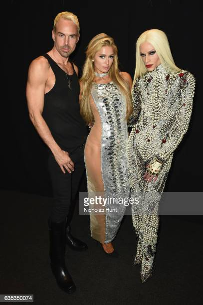 David Blond Paris Hilton and designer Phillipe Blond pose backstage for the The Blonds collection during New York Fashion Week The Shows at Gallery 1...