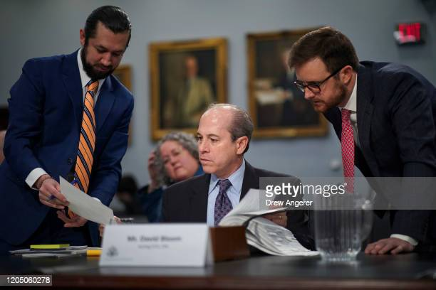 David Bloom , acting chief financial officer of the U.S. Environmental Protection , confers with aides as he arrives for a House Appropriations...