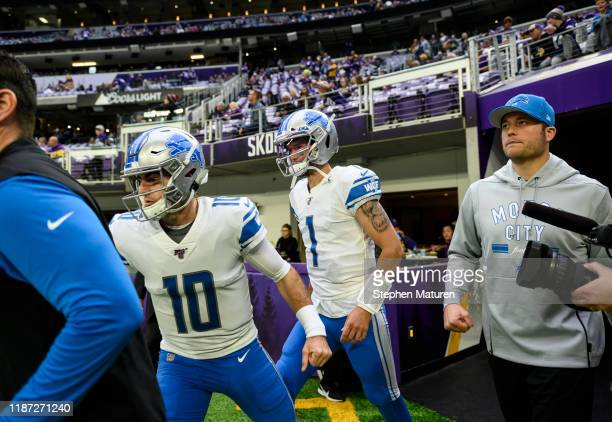 David Blough Kyle Sloter and Matthew Stafford of the Detroit Lions take the field before the game against the Minnesota Vikings at US Bank Stadium on...