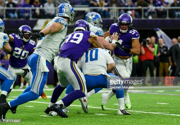David Blough of the Detroit Lions is sacked with the ball by Danielle Hunter of the Minnesota Vikings in the first quarter of the game at US Bank...