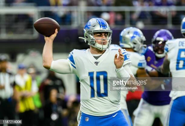 David Blough of the Detroit Lions passes the ball in the first quarter of the game against the Minnesota Vikings at US Bank Stadium on December 8...