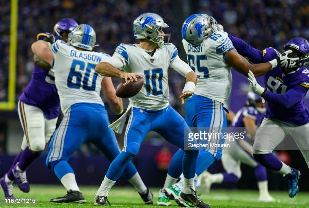 David Blough of the Detroit Lions passes the ball in the third quarter of the game against the Minnesota Vikings at US Bank Stadium on December 8...