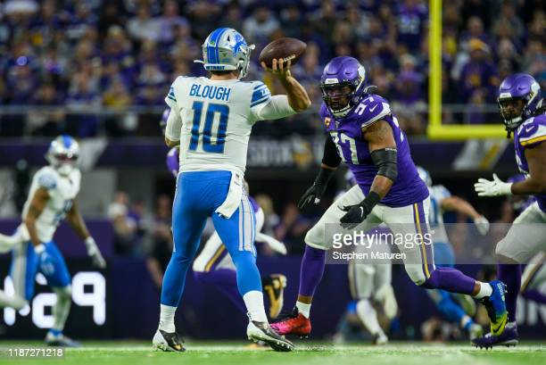 David Blough of the Detroit Lions throws the ball while under pressure from Everson Griffen of the Minnesota Vikings in the third quarter of the game...