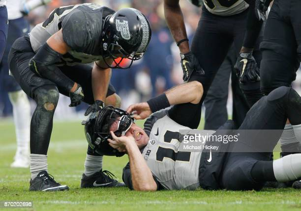 David Blough of the Purdue Boilermakers lies on the ground hurt before being carted off during the game against the Illinois Fighting Illini at...