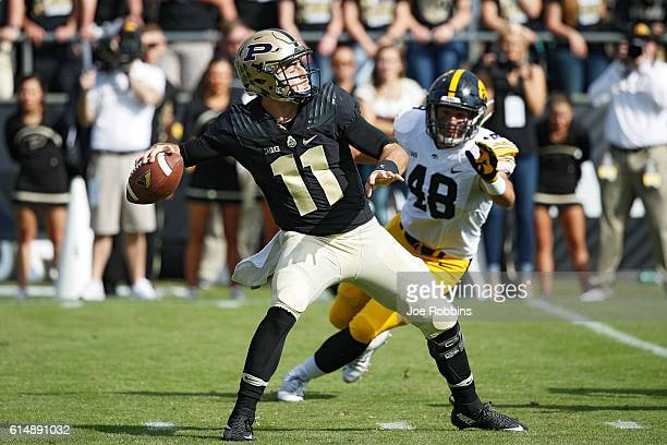 David Blough of the Purdue Boilermakers passes against the Iowa Hawkeyes in the second half of the game at RossAde Stadium on October 15 2016 in West...