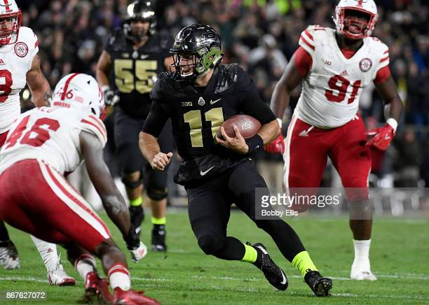 David Blough of the Purdue Boilermakers runs with the ball during the second quarter of the game between the Purdue Boilermakers and the Nebraska...