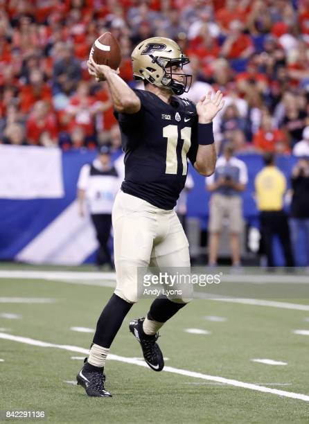 David Blough of the Purdue Boilermakers throws a pass during the game against the Louisville Cardinals at Lucas Oil Stadium on September 2 2017 in...