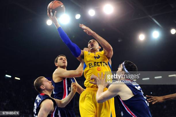 David Blutenthal of Maccabi Electra vies with Efes Pilsen's Daniel Santiago Bojan Popovic and Bostchan Nachbar during their Euroleague group match at...